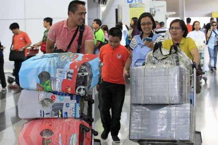 People wrapping their luggage tight at Manila's extortion-ridden airport